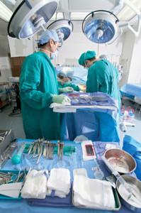 Surgeons Performing Surgery --- Image by © Robert Llewellyn/CORBIS